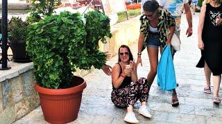 She fell on ground!! Way too funny!! Bushman Prank!